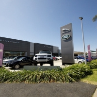 Plantability Landscaping Lush Green way around Car Dealership
